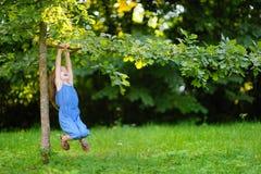 Cute little girl having fun in a park Stock Photography