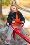 Cute little girl having fun on the playground Stock Photography