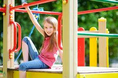 Cute little girl having fun on a playground Royalty Free Stock Photo