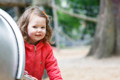 Cute little girl having fun on playground Stock Image