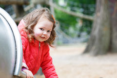 Cute little girl having fun on playground Royalty Free Stock Photography