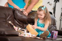 Cute little girl having fun with presents Royalty Free Stock Photos