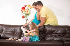 Cute little girl having fun with presents Royalty Free Stock Image