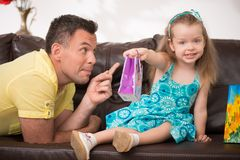Cute little girl having fun with presents Stock Photos