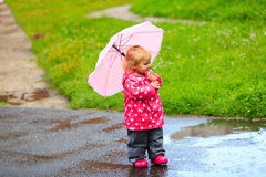 Cute little girl having fun on rain Stock Photo