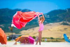 Cute little girl having fun running with towel on Royalty Free Stock Photos