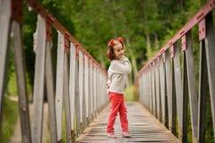 Cute little girl having fun in a rural bridge Royalty Free Stock Images