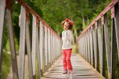 Cute little girl having fun in a rural bridge Stock Image