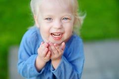 Cute little girl having fun on a summer day Stock Photos
