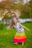 Cute little girl having fun in summer park Stock Image