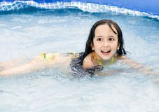 Cute little girl having fun in the swimming pool Royalty Free Stock Photography