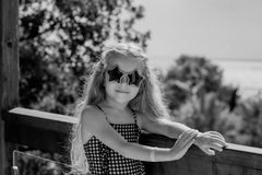 Cute little girl is having fun on a terrace Royalty Free Stock Image