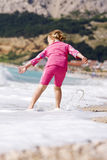 Cute little girl having some fun in ocean waves. Cute child having some fun in ocean somewhere in Croatia Royalty Free Stock Photos