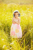Cute little girl with headphones Stock Image