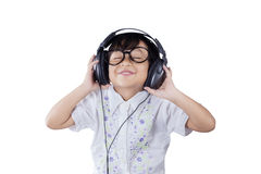 Cute little girl with headphones Royalty Free Stock Image