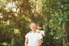 Cute little girl healing massage grandfather.  Stock Photography