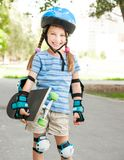 Cute little girl in a helmet Stock Images