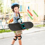 Cute little girl in a helmet Stock Photography