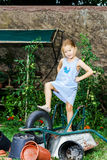 Cute little girl helping her mother in the backyard Royalty Free Stock Images