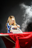 Cute little girl helping your mother by ironing clothes, contras Royalty Free Stock Images