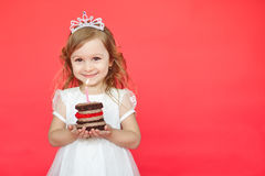 Cute little girl and her birthday cake on red background Royalty Free Stock Photography
