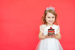 Cute little girl and her birthday cake on red background Royalty Free Stock Image