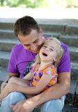 Cute little girl with her father– Outdoor Stock Photo