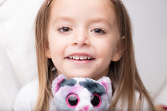 Cute little girl with her favourite stuffed toy Stock Images