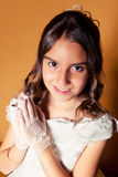 Cute Little Girl in her First Communion Day Stock Photo