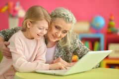 girl with grandmother using laptop Royalty Free Stock Photo