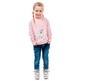 Cute little girl with her hands in pockets Stock Photos