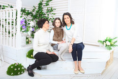 Cute little girl, her mother and grandmother. Together on this portrait stock photography