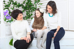 Cute little girl, her mother and grandmother Stock Image
