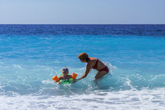 Cute little girl with her mother learning to swim Stock Photography