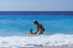 Cute little girl with her mother learning to swim Royalty Free Stock Photos