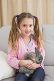 Cute little girl with her pet bunny Royalty Free Stock Photography