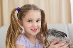 Cute little girl with her pet bunny Stock Image