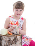 Cute little girl with her pet rabbit Stock Images