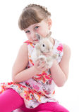 Cute little girl with her pet rabbit Royalty Free Stock Images