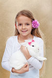 Cute little girl with her rabbit Royalty Free Stock Images