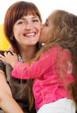 Cute little girl and her smiley mother Royalty Free Stock Images