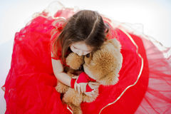 Cute little girl  with her teddy-bear toy friend Stock Images