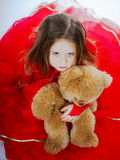 Cute little girl  with her teddy-bear toy friend Royalty Free Stock Images