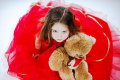 Cute little girl  with her teddy-bear toy friend Stock Photo