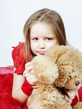 Cute little girl  with her teddy-bear toy friend Stock Image
