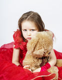 Cute little girl  with her teddy-bear toy friend Royalty Free Stock Photography