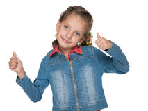 Cute little girl with her thumbs up stock image