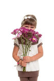 Cute little girl hided her face by bunch of flowers Stock Photography