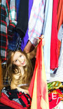 Cute little girl hiding inside wardrobe from her parents Stock Photography