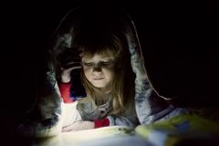 Little girl bed read Royalty Free Stock Photos